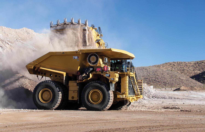 Cat 798 mining truck loading a Cat 6060 hydraulic mining shovel